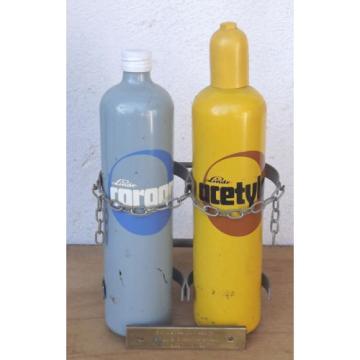 Linde Acetylene/Corgon Schnapps bottles on hand trucks - Decorational object