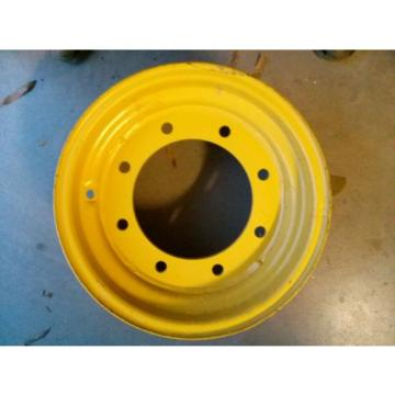 New Komatsu Backhoe model WB140-2N front rim. Part number 2938306064