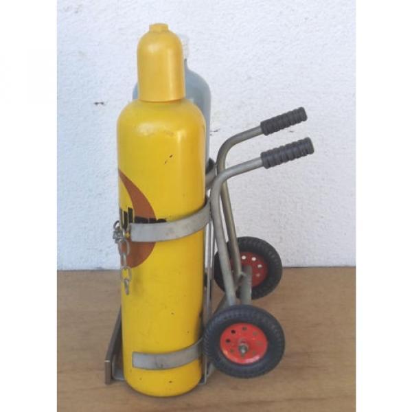 Linde Acetylene/Corgon Schnapps bottles on hand trucks - Decorational object #2 image