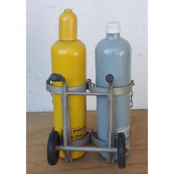 Linde Acetylene/Corgon Schnapps bottles on hand trucks - Decorational object #3 image